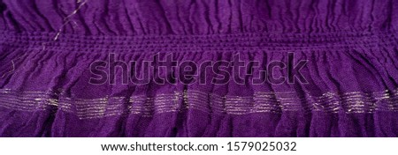 Texture background pattern, decor ornament, dark lilac corrugated fabric of blue cent, Fabric with parallel or diagonal folds of dentate folds; products from such a fabric. #1579025032
