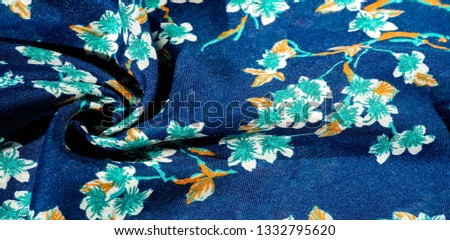 Texture, background, pattern, fabric blue with green colors of flowers. Your possibilities are endless! Courage and success will be yours! #1332795620