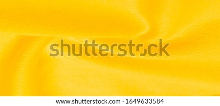 Texture background pattern Fabric warm wool yellow A pair of acrylic felt fabric has a phenomenal color. Condensation of felt oil and pressing the fibers together This is a special fabric for design