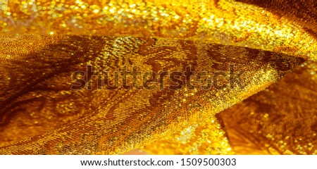 Texture background, pattern. fabric; yellow gold brocade. Organza brocade fabric - shepherd, with a crunchy palm. It has a large yarn-dyed flower embroidered pattern throughout. #1509500303