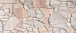 Texture background pattern. Granite stone, sandstone. finishing of buildings fences,  sedimentary rock, consisting of sand or quartz grains, cemented together typically red, yellow, or brown in color
