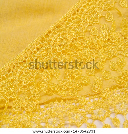 Texture, background, pattern, postcard, silk fabric, female yellow scarf with lace wrappers. Use these fancy images to create your print and digital materials. #1478542931
