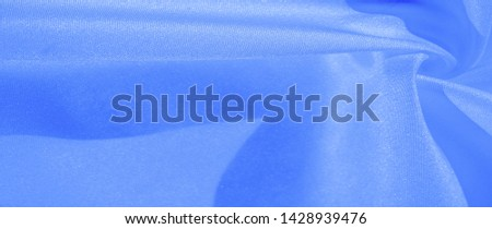 Texture, background, pattern, silk blue fabric. Crepe satin on the back is an excellent fabric for design, on the one hand it has a satin finish, and on the other - crepe, which makes it reversible, #1428939476