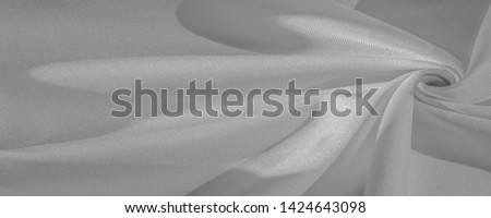 Texture, background, pattern, silk fabric of white color, solid light white silk satin fabric of the duchess Really beautiful silk fabric with satin sheen. Perfect for your design, wedding invitations