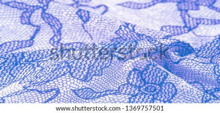 texture, background, pattern. Silk white fabric with lace patterns. This elastic lace trim can add a delicate touch to everything Decorate your jewelry with your projects, crafts and Internet decor #1369757501
