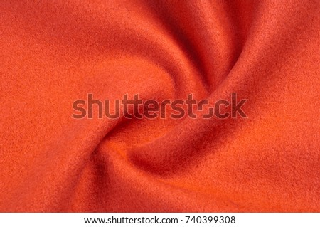 Texture, background, pattern. Vicuña fabric is a luxurious rarity. Drape of monochromatic red color #740399308