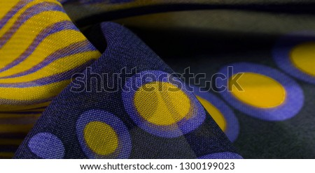 texture background pattern wallpaper. blue black yellow silk fabric pattern. This medium-weight rayon fabric has a nice shine with slight color variations. Perfect for adding elegance to your designs