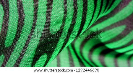 texture background pattern wallpaper. Green pink black silk fabric pattern. This medium-weight rayon fabric has a nice shine with slight color variations. Perfect for adding elegance to your designs #1292446690