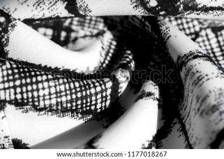 Stock Photo texture, background, pattern. white fabric with black abstract figures. Inspiration lies at the heart of every project. Regardless of whether you create a beautiful design, or make crafts,