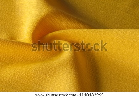 Texture, background, pattern. Yellow jacquard fabric. Providing both a texture and a thin structure, they demonstrate a quilted hand in a wave of geometric design. Jacquard has a transparent opacity #1110182969