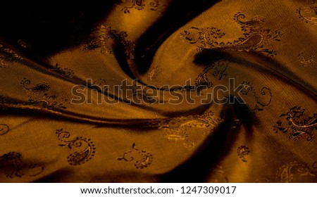 Texture background pattern Yellow mustard brown chiffon fabric with paisley print High quality pure silk chiffon fabric bright beautiful color combinations This fabric is suitable for design wallpaper #1247309017