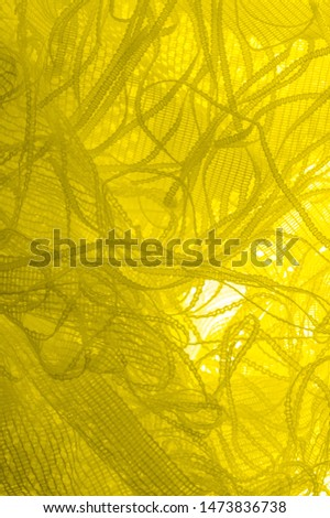 Texture, background, pattern. yellow tulle. With a simple design idea, create a couture look that refers to the softness of spring. In a collection of beautiful shades, how could you say no? #1473836738