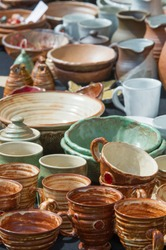 Texture, background. Pottery. pots, dishes, and other articles made of earthenware or baked clay. Pottery can be broadly divided into earthenware, porcelain, and stoneware.
