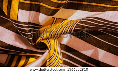 Texture, background, silk fabric with a yellow striped pattern. The design of this fabric is dedicated to a white rabbit mosaic representing the look of a fabulous vest. #1366552910