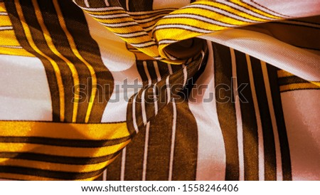Texture, background, silk fabric with a yellow striped pattern. The design of this fabric is dedicated to a white rabbit mosaic representing the look of a fabulous vest. #1558246406