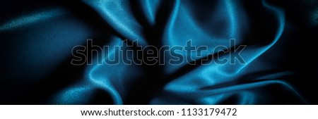Stock Photo Texture, background. template. Silk fabric blue, Blue silk drapery and upholstery fabric from the courtyard - Dark curtains - Solid fabrics for backs and pillows