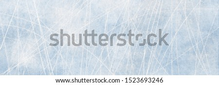Texture blue ice surface with scratches of skates as background for advertising surfaces in winter #1523693246