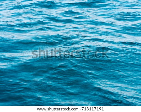 Texture blue ripples water in sea ocean for background. Surface of blue water in nature ocean. #713117191
