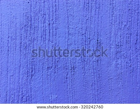 Texture concrete painted with purple paint