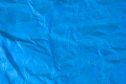 Texture crumpled blue paper background.