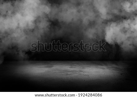 Texture dark concentrate floor with mist or fog. Black, dark and gray abstract cement wall and studio room , interior texture for display products