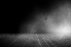 Texture dark concrete floor with mist or fog