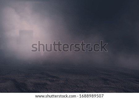 Texture dark soil field  with mist or fog