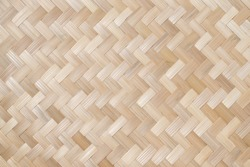 Texture details of bamboo weave. Vertical zigzag pattern of Thai wickerwork for furniture made from natural materials for background.