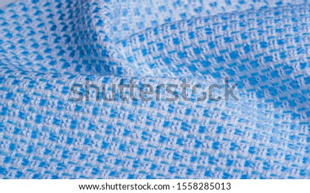 Texture, fabric, pattern. Large weave of blue and white threads, tightly woven fabric with a very simple over-under weave and very little sheen, which makes it nice and professional. #1558285013