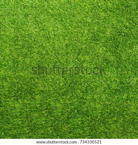 Texture green grass. Background of green turf grass. Texture coating of a football field. Green lawn - Shutterstock ID 734330521