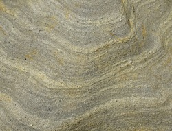 Texture image of limestone rock cliff with unique and rare curve wave and multiple layers pattern on the surface. Light grey color seamless grunge rock background, copy space for text quote geology
