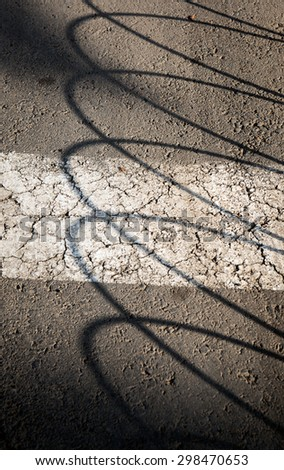 Texture, lights and shadows on pavement