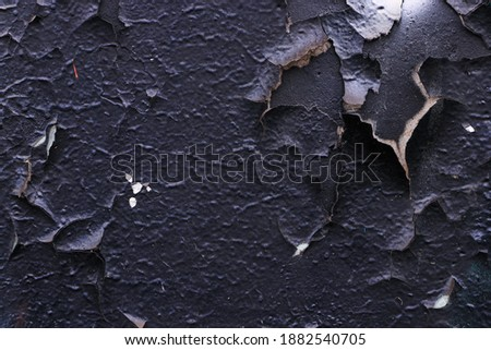 Texture of a black wall with peeling old paint. Stock photo ©