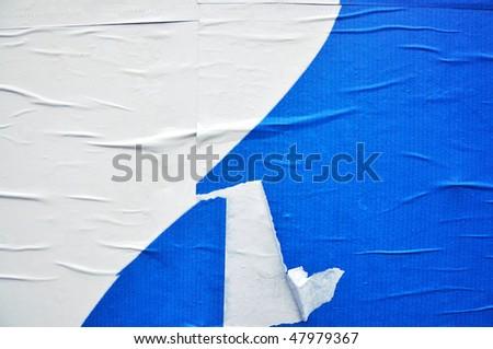 texture of a blue printed billboard paper, closeup