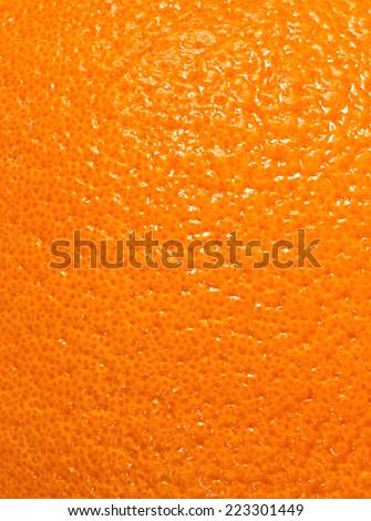 texture of a bright orange peel ...