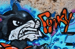 Texture of a fragment of the wall with graffiti painting, which is depicted on it. An image of a piece of graffiti drawing as a photo on street art and graffiti culture topics