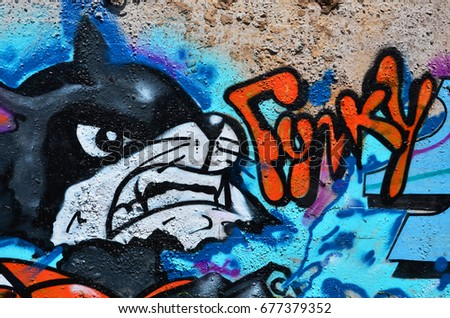 Shutterstock Texture of a fragment of the wall with graffiti painting, which is depicted on it. An image of a piece of graffiti drawing as a photo on street art and graffiti culture topics