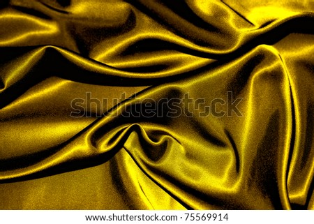 texture of a gold satin extreme close up