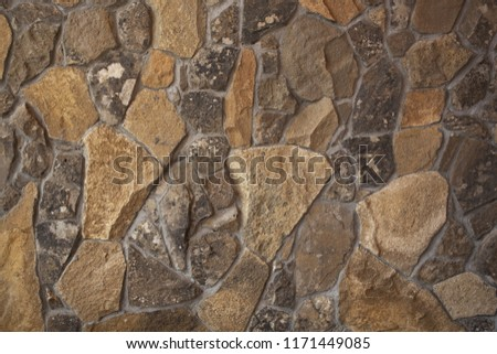 Texture of a gray stone wall #1171449085