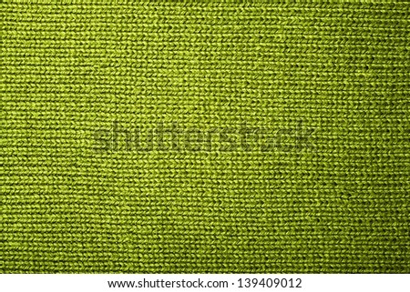 texture of a green knitted fabric close up