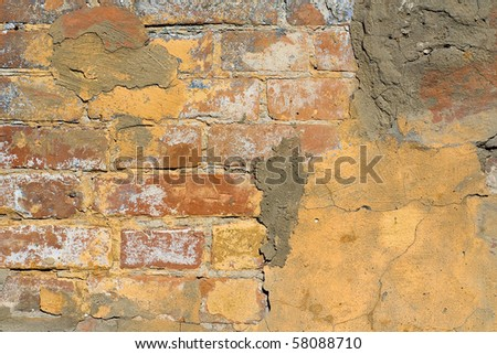Texture of a old painted wall with plaster fragment
