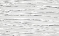Texture of a paint of white color with patterns. Background with divorces for various purposes.