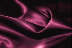 Texture of a pink silk closeup