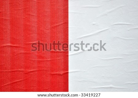 texture of a red and white printed billboard paper, closeup - stock photo