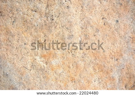 texture of a sandstone rock with reddish surface