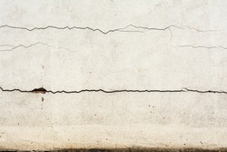 Texture of a white wall with horizontal crack, architecture abstraction background