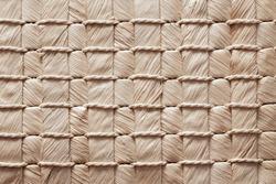 texture of a wicker mat, baskets, handbags made of natural materials, weaving of fibers, handmade with bark