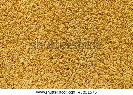 texture of a yellow  carpet with long  pile.