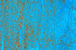 Texture of an old blue painted metallic surface with rust stains for background.