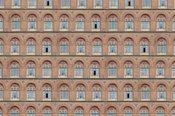 Texture of an old brick facade with antique windows